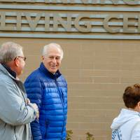 Tour group walks into Holton Hooker Living Center